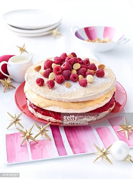Meringue layer cake with raspberries and macadamia nuts