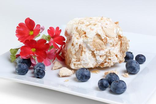 Meringue, sponge cake and blueberries dessert