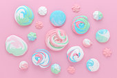 meringues in pastel colors, pattern abstract on pink background horizontal