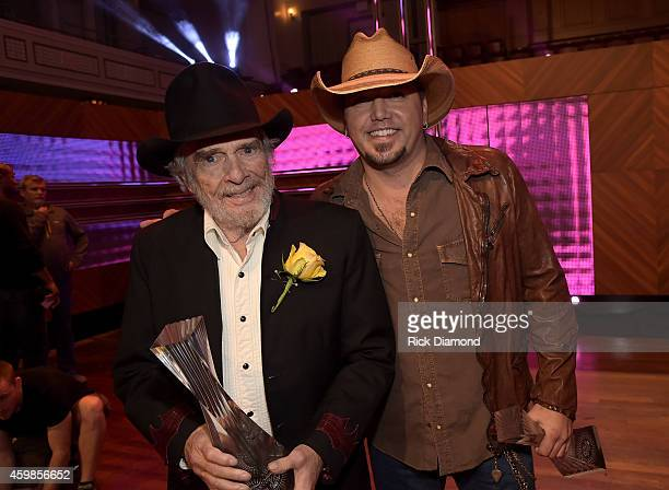 Merle Haggard and Jason Aldean attend the 2014 CMT Artists Of The Year at the Schermerhorn Symphony Center on December 2 2014 in Nashville Tennessee