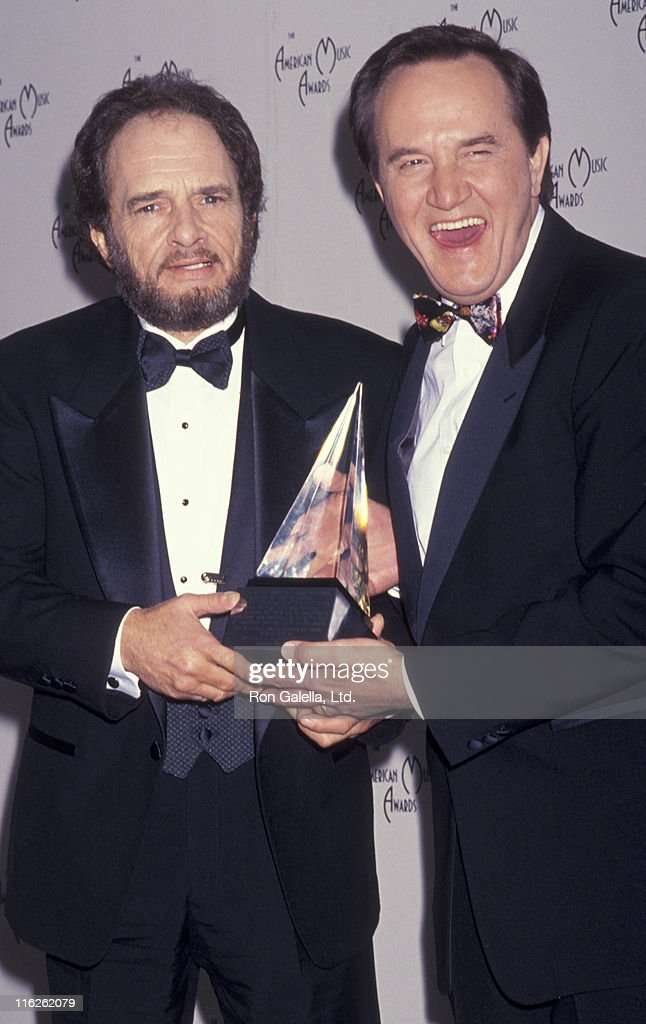 Merle Haggard and Roger Miller attend 18th Annual American Music Awards on January 28 1991 at the Shrine Auditorium in Los Angeles California