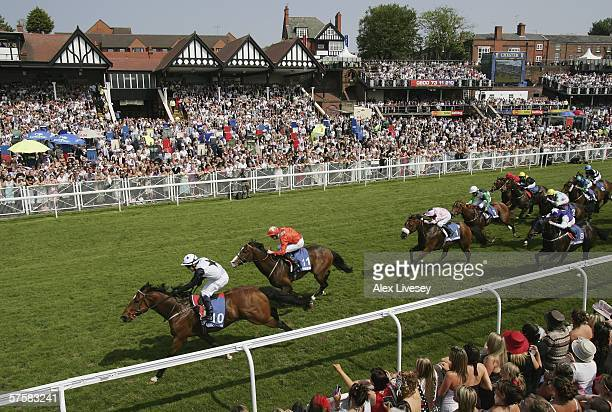 Merlin's Dancer ridden by Adrian Nicholls wins the Betfred Handicap Stakes during the May Festival at Chester Racecourse on May 11 2006 in Chester...
