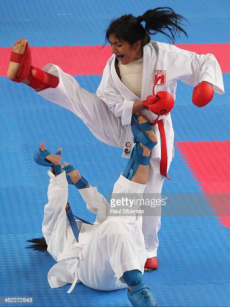 Merly Huamani of Peru and Amanda Mendoza of Panama compete in women's karate 50kg eventas part of the XVII Bolivarian Games Trujillo 2013 at San Jose...