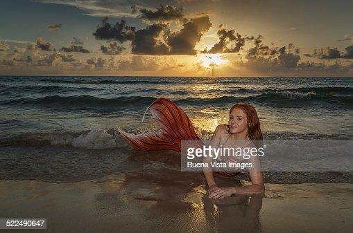 Mermaid on the beach at sunset : Stock Photo