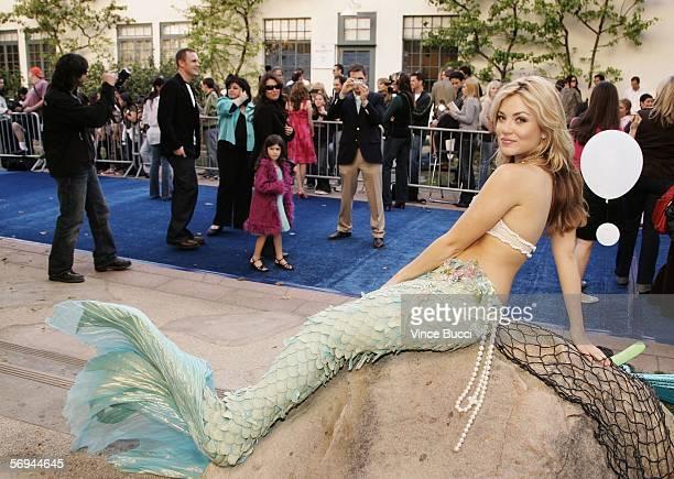 A mermaid poses at the premiere of the Twentieth Century Fox film 'Aquamarine' on February 26 2006 at the Fox Studio Lot in Los Angeles California