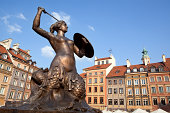 'Warsaw's mermaid statue located in the center of Old Town square. Warsaw's Old Town Market Place is the center and oldest part of the Old Town of Warsaw, capital of Poland. Immediately after the Wars