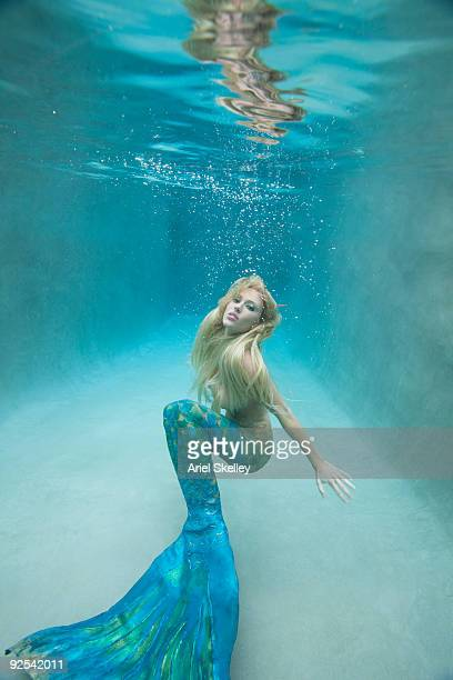 Mermaid Swimming Under Water