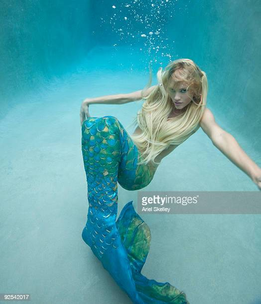 Mermaid Swimming Under Water