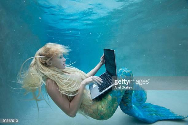 Mermaid Using Laptop Computer Under Water