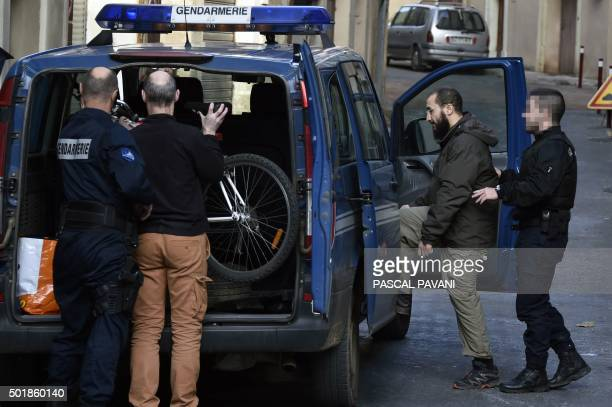 Merouane Benahmed an Algerian Islamist and former member of the GIA who is currently under house arrest is escorted by French gendarmes on December...