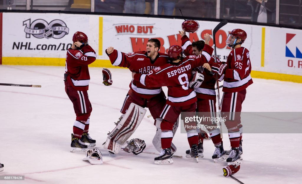 Merrick Madsen #31 of the Harvard Crimson celebrates with teammates after beating the Boston University Terriers during NCAA hockey in the championship game of the annual Beanpot Hockey Tournament at TD Garden on February 13, 2017 in Boston, Massachusetts. The Crimson won the game 6-3 and captured its first Beanpot Championship since 1993.