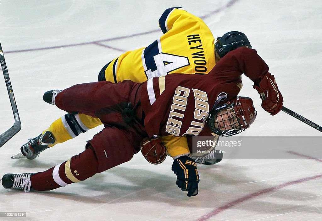 Merrimack's Jordan Heywood (#4) received a two minute penalty for holding as he took down Boston College's Johnny Gaudreau as they both pursued the puck that was sliding towards the Merrimack net in the first minute of the game. Merrimack College hosted Boston College in a men's hockey game at Lawler Arena on the Merrimack campus.
