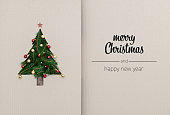 Merry Christmas and happy new year greetings in vertical top view cardboard with natural eco decorated christmas tree pine.Ecology concept.Xmas winter holiday season social media card background.