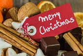 Tag with text Merry Christmas and Christmas sweets decoration