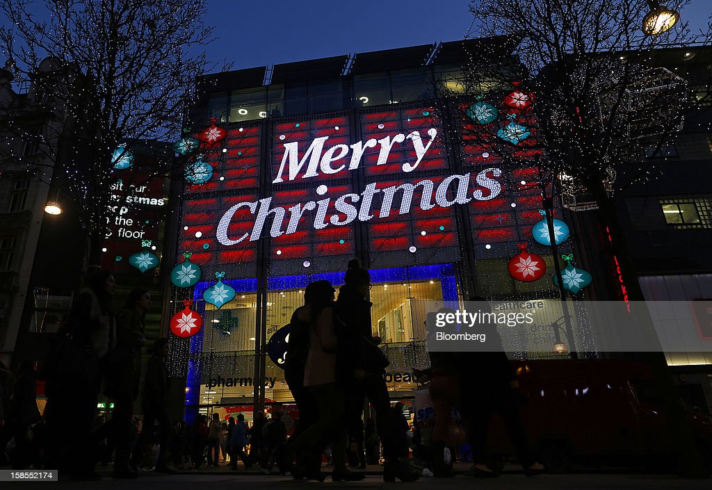 A 'Merry Christmas' sign hangs above the entrance to a Boots store, operated by Alliance Boots, on Oxford Street in London, U.K., on Monday, Dec. 17, 2012. Retailers are relying on Christmas sales to help rescue a year when high unemployment and the debt crisis have blighted spending. Photographer: Simon Dawson/Bloomberg via Getty Images