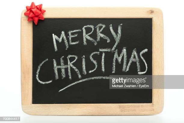 Merry Christmas Text On Chalkboard Against White Background