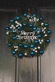 Merry Christmas wreath on a door