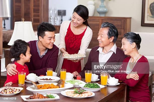 Merry family having Chinese New Year dinner