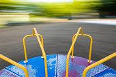 Merry Go-Round Spinning, Motion Blur of Background