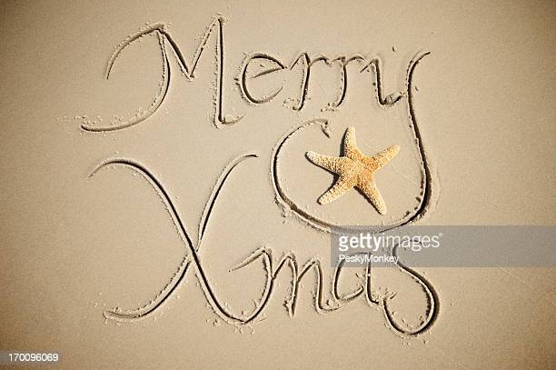 Merry Xmas Christmas Greeting Message in Sand with Cute Starfish