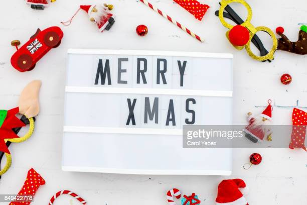 merry xmas in a lightbox in white  background