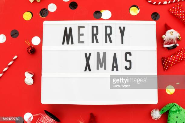 merry xmas in a lightbox Red background