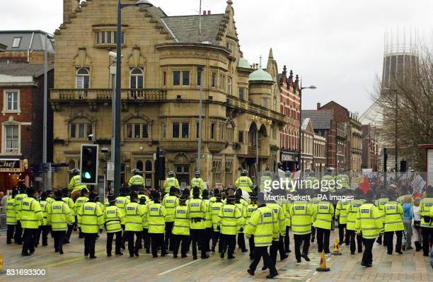 Merseyside Police Force Antiwar protesters back down Hope Street during the visit of US Secretary of State Condoleeza Rice Friday March 31 2006 ahead...