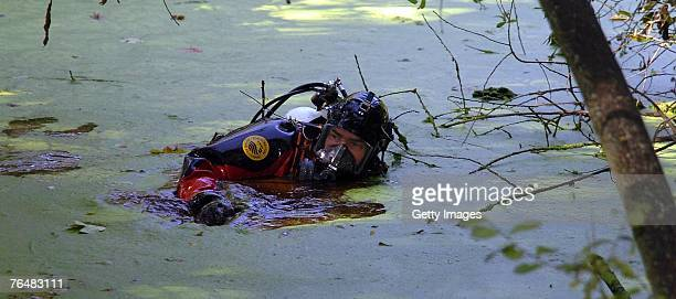 Merseyside Police underwater search team examine a pond in Dam Wood close to the scene where Rhys Jones was shot on the 29 August 2007 near the...