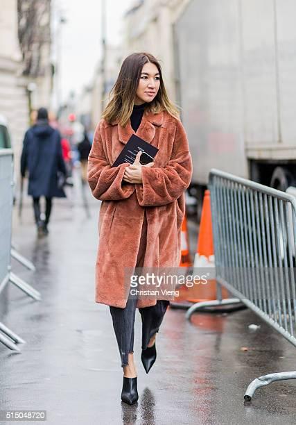 Meruyert Ibragim wearing a fur coat outside Moncler Gamme Rouge during the Paris Fashion Week Womenswear Fall/Winter 2016/2017 on March 9 2016 in...