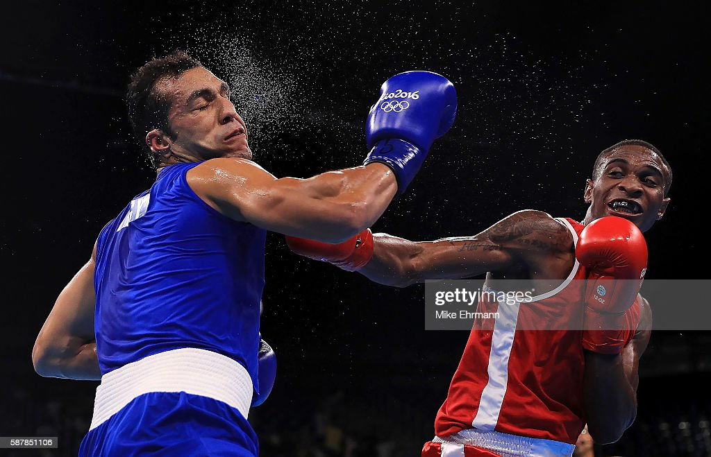 Merven Clair of Mauritius fights against Hosam Hussein Bakr Abdin of Egypt in their Mens Middleweight 75kg bout on Day 4 of the Rio 2016 Olympic...