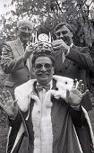 Mervin Stewart proprietor of the Guinea Pig Restaurant about to be crowned 'King of Dalkey' by Jack Kelly circa 1986 Photographer Michael MacSweeney
