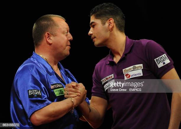 Mervyn King and Jelle Klaasen shake hands at the end of there match