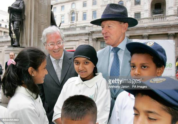 Mervyn King Chance to Shine President and Governor of the Bank of England left and Geoffrey Boycott talk to pupils from Seven Mills Primary school in...