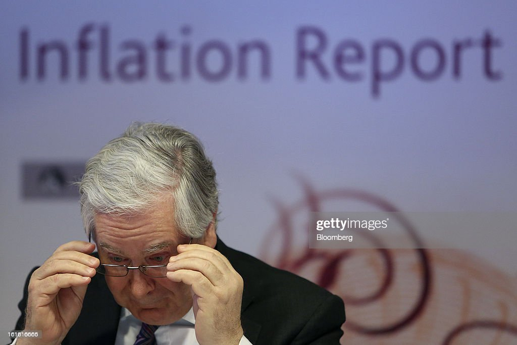 Mervyn King, governor of the Bank of England, adjusts his spectacles during the bank's quarterly inflation report news conference at the Bank of England, in London, U.K., on Wednesday, Feb. 13, 2013. King said Britain faces a further bout of inflation and a muted economic recovery, and pledged officials will look through the volatility in prices to keep nurturing growth where they can. Photographer: Chris Ratcliffe/Bloomberg via Getty Images