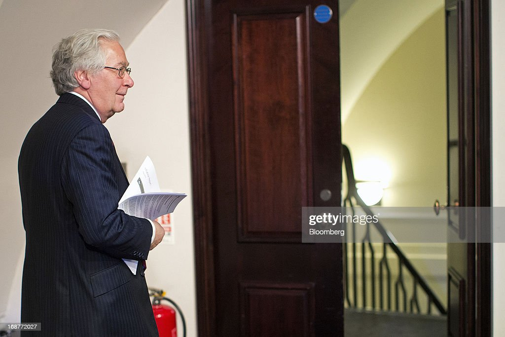 <a gi-track='captionPersonalityLinkClicked' href=/galleries/search?phrase=Mervyn+King+-+Economist&family=editorial&specificpeople=14888473 ng-click='$event.stopPropagation()'>Mervyn King</a>, governor of the Bank of England, exits following the bank's quarterly inflation report news conference at the Bank of England in London, U.K., on Wednesday, May, 15, 2013. The Bank of England raised its forecasts for economic growth and said it may hit its 2 percent inflation target quicker than previously estimated. Photographer: Simon Dawson/Bloomberg via Getty Images