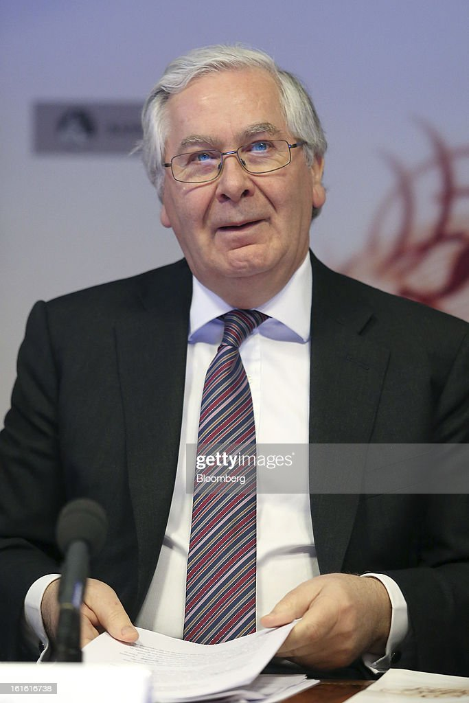 Mervyn King, governor of the Bank of England, prepares his papers ahead of the bank's quarterly inflation report news conference at the Bank of England, in London, U.K., on Wednesday, Feb. 13, 2013. King said Britain faces a further bout of inflation and a muted economic recovery, and pledged officials will look through the volatility in prices to keep nurturing growth where they can. Photographer: Chris Ratcliffe/Bloomberg via Getty Images
