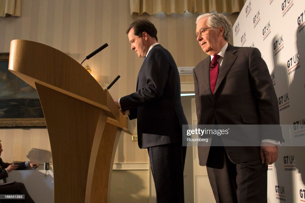 Mervyn King, governor of the Bank of England, right, and <a gi-track='captionPersonalityLinkClicked' href=/galleries/search?phrase=George+Osborne&family=editorial&specificpeople=5544226 ng-click='$event.stopPropagation()'>George Osborne</a>, U.K. chancellor of the exchequer, arrive for a news conference at the Group of Seven (G-7) finance ministers and central bank governors meeting at Hartwell House in Aylesbury, U.K., on Saturday, May 11, 2013. Global finance chiefs clashed over the correct speed of budget cutting as they sought fresh ways to rally the slowing world economy. Photographer: Simon Dawson/Bloomberg via Getty Images