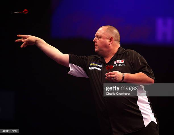 Mervyn King of England in action during his first round match against Max Hopp of Germany during the William Hill PDC World Darts Championships on...