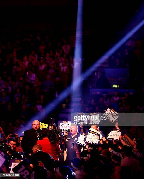 Mervyn King of England makes his entrance during his first round match against Max Hopp of Germany during the William Hill PDC World Darts...