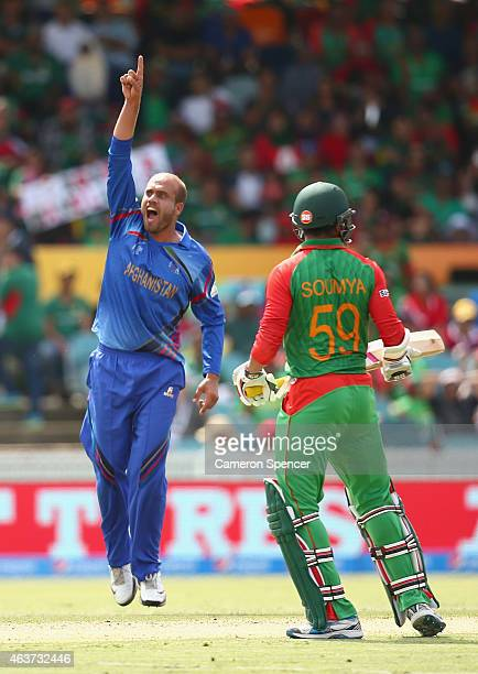 Merwais Ashraf of Afghanistan celebrates dismissing Anamul Haque of Bangladesh for lbw during the 2015 ICC Cricket World Cup match between Bangladesh...