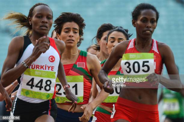 Meryem Akdag of Turkey Rababe Arafi of Morocco and Tigist Gashaw of Bahrain lead ahead of the last laps in Women's 1500m final during day four of...
