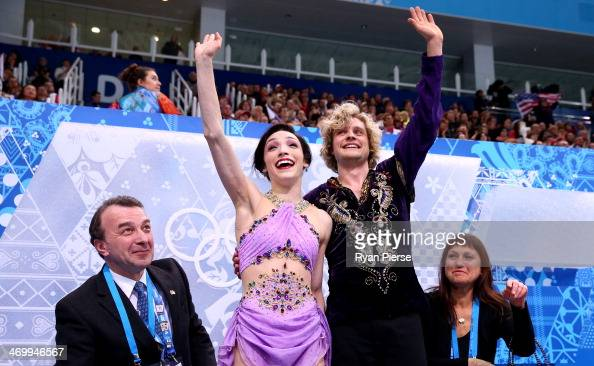 Meryl Davis and Charlie White of the United States wave to fans after competing in the Figure Skating Ice Dance Free Dance on Day 10 of the Sochi...