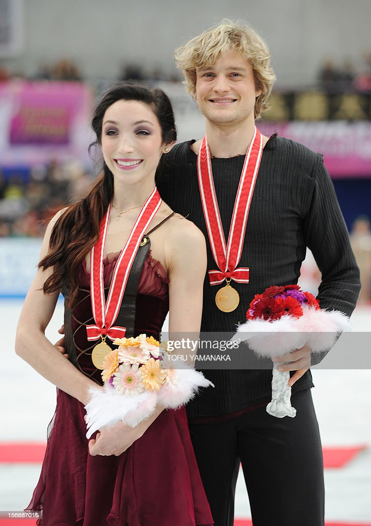 Meryl Davis (L) and Charlie White (R) of the US pose for photographers during the award ceremony for the ice dance event in the NHK Trophy, the last leg of the six-stage ISU figure skating Grand Prix series, in Rifu, northern Japan, on November 24, 2012. The American couple won the gold medal in the competition. AFP PHOTO/Toru YAMANAKA