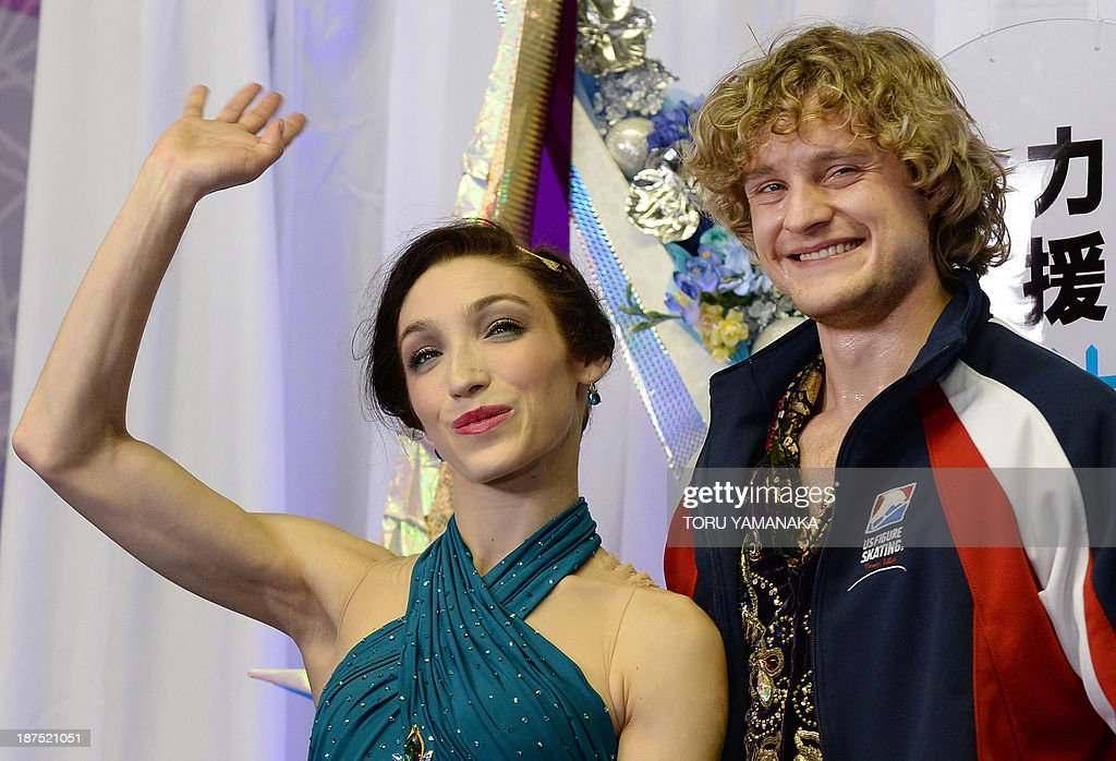 Meryl Davis (L) and Charlie White (R) of the US react after their free dance event in the NHK Trophy, the fourth leg of the six-stage ISU figure skating Grand Prix series, in Tokyo on November 10, 2013. The US couple won the Ice Dance event. AFP PHOTO/Toru YAMANAKA