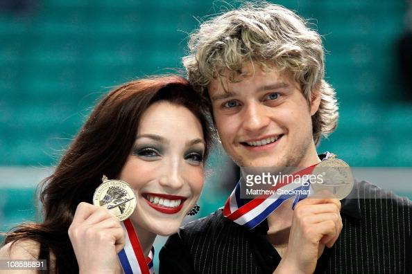 Meryl Davis and Charlie White pose for photographers after winning the Championship Dance competition during the US Figure Skating Championships at...