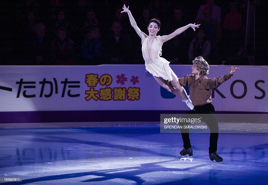 Meryl Davis and Charlie Whiteof the US perform during the exhibition program at the 2013 World Figure Skating Championships on March 17, 2013 in London, Ontario. Gold, silver and bronze medalists of the championships as well as invited skaters performed in the post-competition exhibition. AFP PHOTO/Brendan SMIALOWSKI