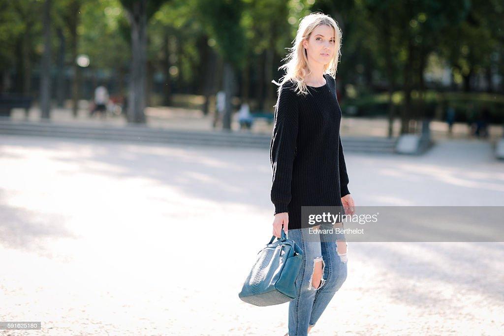 Meryl Denis is wearing a NAKD black pull over Hollister blue denim jeans pants a green Kate Lee bag and Public Desire transparent shoes on August 17...