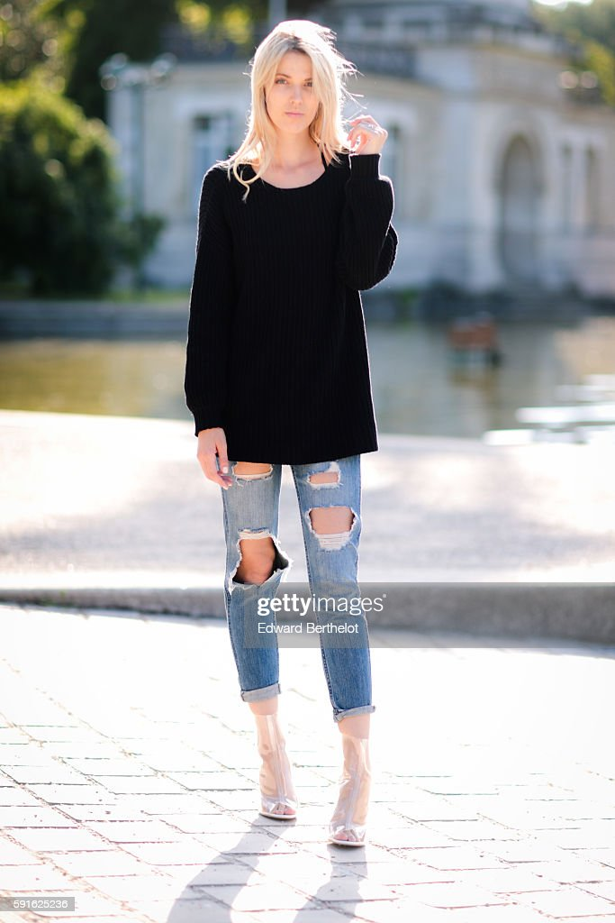 Meryl Denis is wearing a NAKD black pull over Hollister blue denim jeans pants and Public Desire transparent shoes on August 17 2016 in Paris France