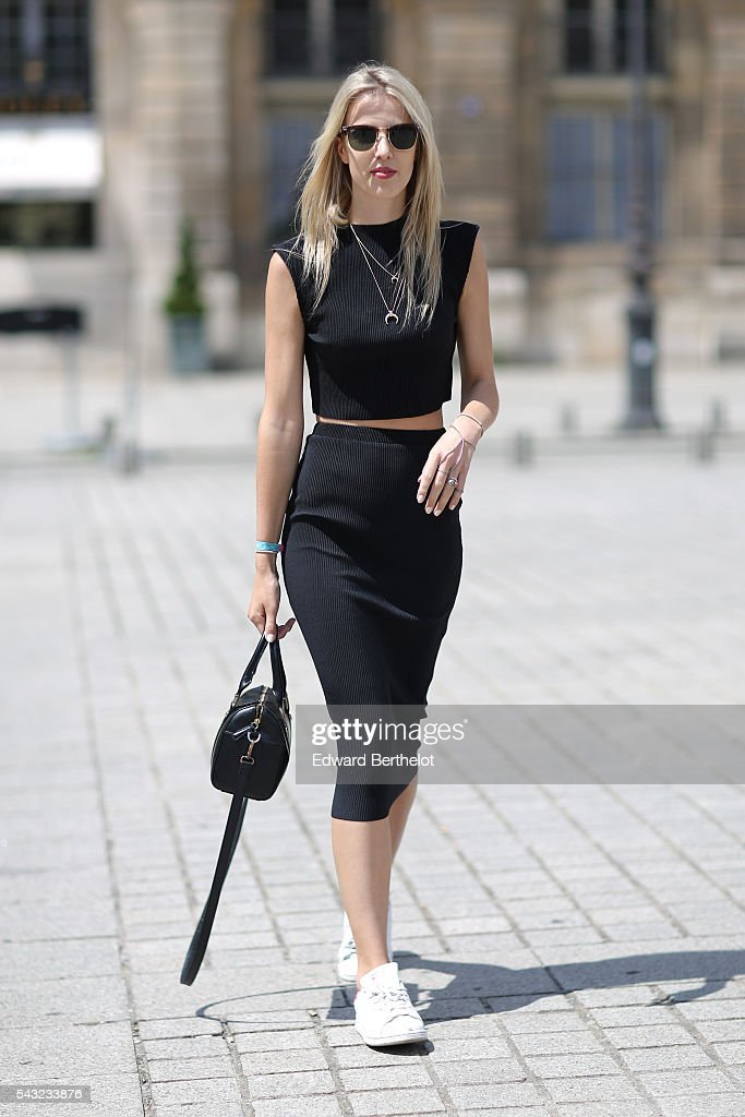 Meryl Denis is wearing an Agnes B. bag, Adidas Stan Smith shoes, a NA-KD top, and a NA-KD skirt, before the Sean Suen show, during Paris Fashion Week Menswear Spring/summer 2017, on June 26, 2016 in Paris, France.