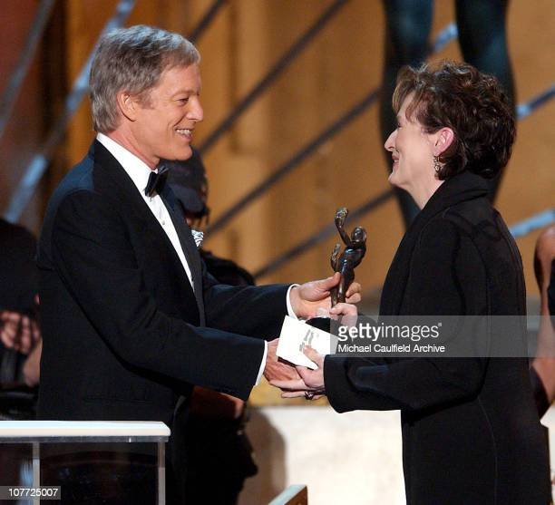 Meryl Streep accepts her award from presenter Richard Chamberlain for Outstanding Female Actor in a Television Movie or Miniseries